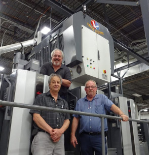 Eagle Systems President and CEO Mike King (top) joins Colbert Packaging's Printing Manager Steve Sifrer (left) and Corporate Facilities Manager Barney McLin at Colbert's RMGT V3000 six-color press, which is equipped with an Eagle cold-foil unit and a coater.