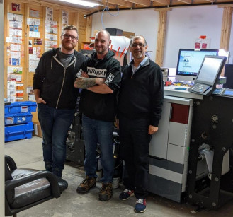 Specialized Marking System's Owner Imran Fancy (right) with his production team and the company's upgraded Mark Andy Digital Pro.