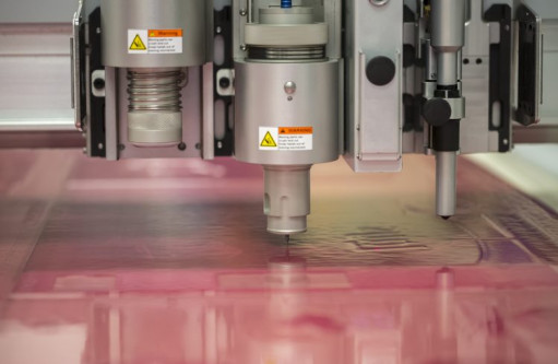 Polymer plates undergo cutting and labeling with specific information. Image courtesy of Cyber Graphics.