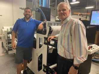 Production Manager Daniel Campbell (left) and Plant Manager Bryan Campbell with Abbott Label's new Rotoflex machine