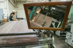 Ha Mai finishes folding cartons at Dee Paper Box Co. The company offers diecutting and finishing in-house.