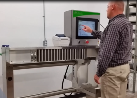 An operator uses the HMJ 300, a high-production ink dispenser from HMJ tech.