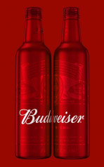 Budweiser's holiday packaging features an entirely red bottle with the brand's logo in white. Via Anheuser-Busch newsroom.