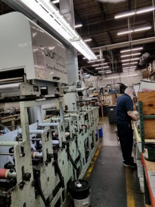 A pressman at Prairie State Group stands next to the company's Mark Andy 2200 flexo press with a Colordyne 3600 Series Retrofit unit.