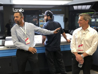 "John Place (right), CEO of Mercury Print Productions, says the company's Landa S10P ""is going to change the way we do business."" With him are Felix Medero (left), Director of Process Development, and Christian Lopez, S10P press operator."