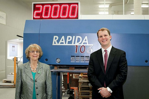 (Left to right) Betina Sommers, co-founder of Allied Printing, and her grandson, John Sommers, president and CEO, with one of their high-speed Rapida 106 presses from Koenig & Bauer.